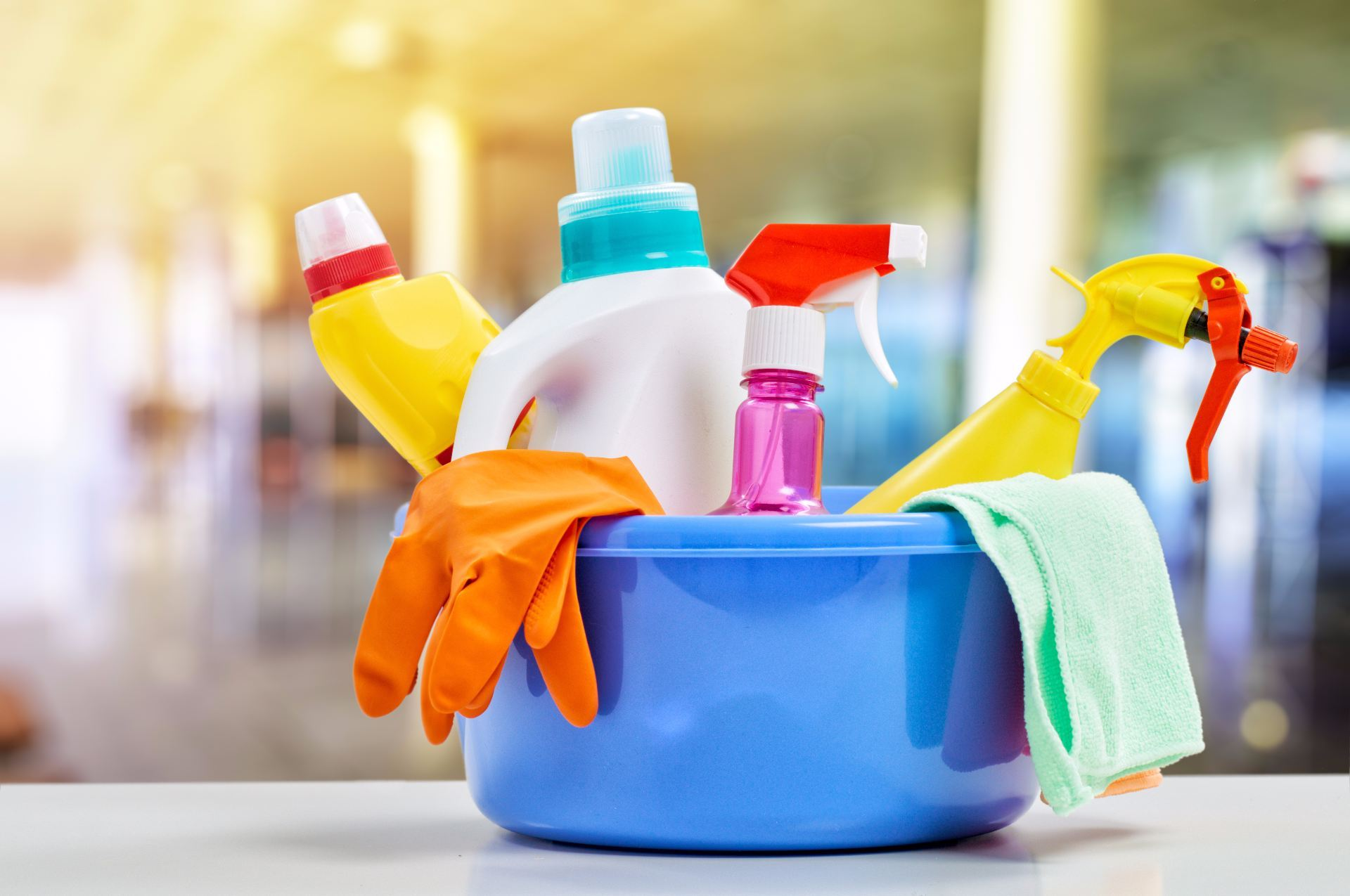 Colourful bucket of spring cleaning supplies